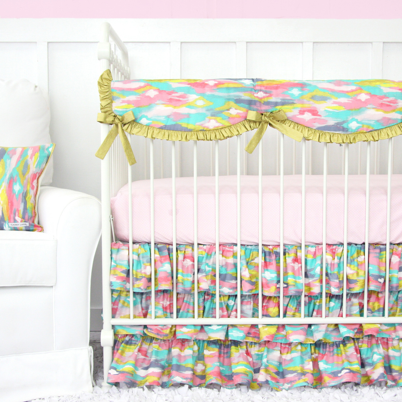 Pastel Nursery Design With Bright Baby Bedding